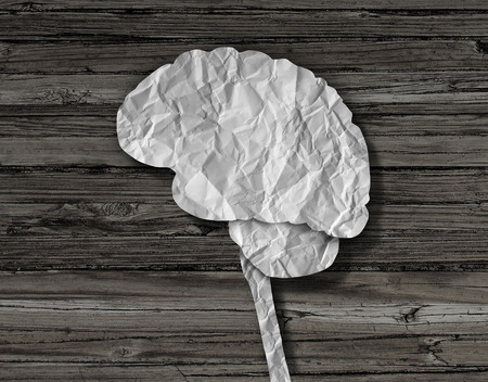 cures: Brain paper medical concept as a crumpled sheet cut into the shape of a human thinking organ as a mental health symbol for neurological diseases and cures.
