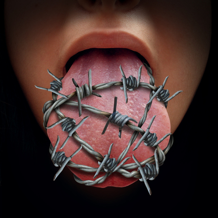 Freedom of speech crisis concept and censorship in expression of ideas symbol as a human tongue wrapped in old barbed wire as a metaphor for political correctness pressure to restrain free talk or limit communication.