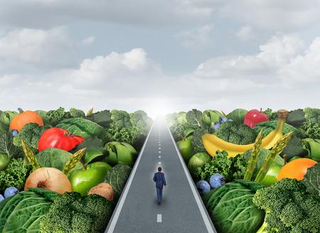 dieta sana: Concepto de alimentación saludable como camino de una persona caminando en una carretera con frutas y verduras como una metáfora de la agricultura para el mercado de alimentos saludables orgánicos frescos o productos modificados genéticamente.