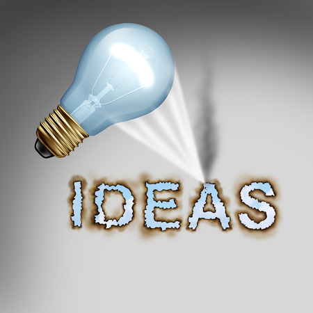 powerful creativity: Idea concept creative symbol with a lightbulb reflecting a hot concentrated beam of light on paper burning letters as a design metaphor for the energy of creativity and powerful thinking.