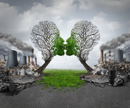 Climate recovery and environmental  renewal as two empty trees shaped as human heads kissing and reviving new green growth  out of a polluted industrial background as a hope metaphor for environment motivation. Archivio Fotografico