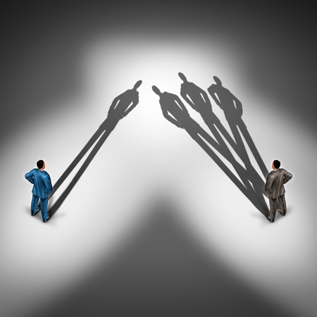 talent management: Worker productivity concept and productive employee symbol as two businessmen with one person with a single cast shadow and another business person with a group of shadows as a skillfull overachiever. Stock Photo