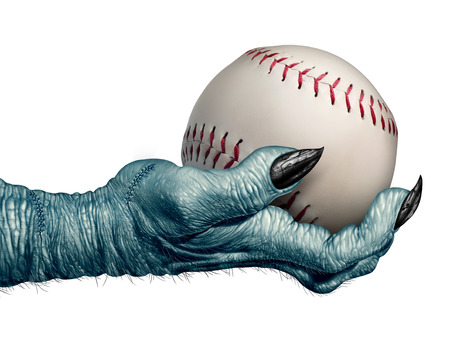 innings: Halloween baseball and autumn ball concept as a creepy zombie or monster hand holding a leather softball as a symbol for halloween sports and fall sporting events on a white background.