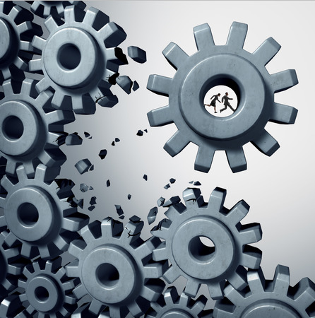 breaking out: Teamwork breaking out business concept as a businessman and businesswoman team inside a cog or gear detaching themselves from the machine as a success motivation for starting a new company. Stock Photo