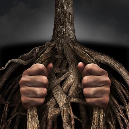 Gevangen concept en de mentale gevangenis symbool als een persoon gekooid en gevangen gezet door de langzaam groeiende wortels van een boom als een metafoor voor chronische ingebakken lijden als gevolg van een verslaving of psychische ziekte.