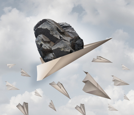 overachiever: Power of motivation business success concept as a paper plane hauling a heavy rock with a group of failing origami airplanes as a metaphor for the force of determination.