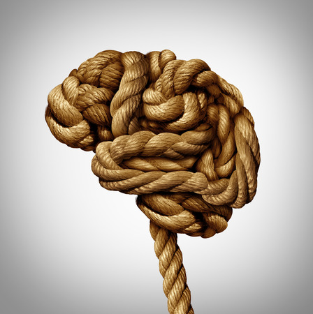 confusion: Tangled brain mental health concept as a rope twisted into a human thinking organ as a medical neurological symbol for mind function or diseases as dementia or autism. Stock Photo