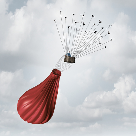 solutions: Business team solution concept and teamwork recovery symbol as a businessman in a deflated broken red hot air balloon being saved and rescued by a group of flying birds pulling the object upward with wires. Stock Photo