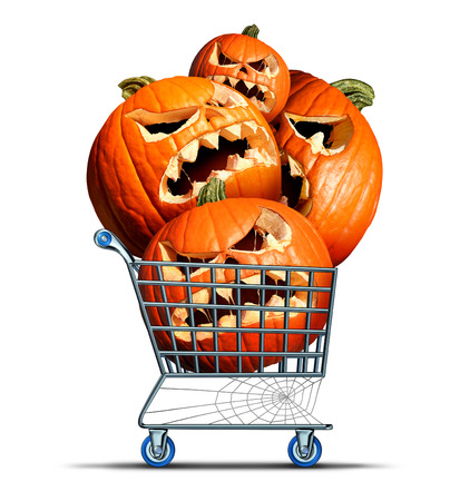 seasonal symbol: Halloween shopping concept and autumn seasonal business buying symbol as a shop cart with a group of jack o lantern pumpkins inside on a white background. Stock Photo