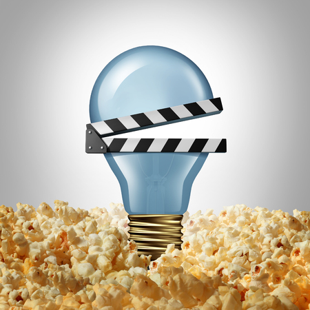 Movie idea concept and cinema creativity symbol as a light bulb or lightbulb in popcorn shaped as an open clap board or video slate as a metaphor for finding new entertainment ideas.