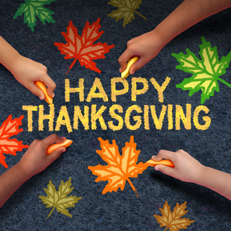 diverse family: Happy thanksgiving day concept as a group of diverse people drawing using chalk on ashpalt the word for traditional family get together during autumn season and community fall celebration.. Stock Photo