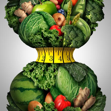 huincha de medir: Dieta de p�rdida de peso saludable como un grupo de las frutas frescas y verduras con una cinta de medir la aptitud envuelto alrededor de una forma cintura encogimiento apretado como una met�fora de la vida de p�rdida de peso saludable. Foto de archivo