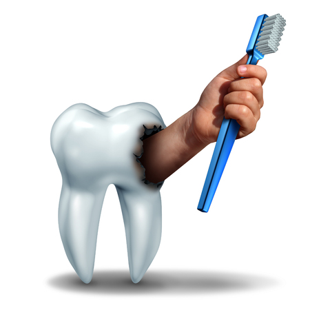 cavities: Brushing teeth concept as a human tooth with a cavity as a hand emerging out holding a generic toothbrush or tooth brush as a dental health care symbol for oral hygiene to avoid cavities on teeth. Stock Photo