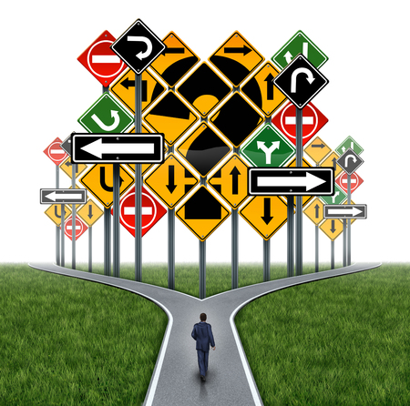 business dilemma: Business decision challenge concept as a businessman on a crossroad path facing an impass or dilemma with a group of traffic signs shaped as a question mark as a metaphor for consultation and corporate guidance. Stock Photo