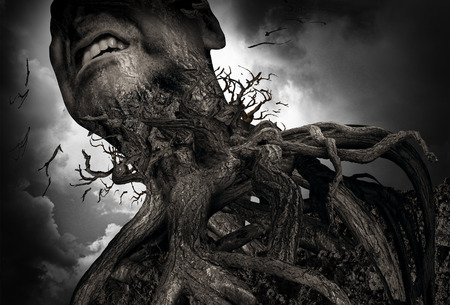 Suffering and pain concept as a tree and roots shaped as a human experiencing intense torture and mental agony as a psychology metaphor for misery or trapped by addiction. 版權商用圖片 - 49008467