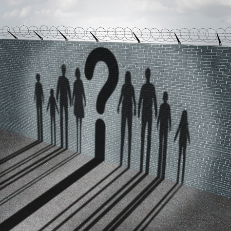 Immigration crisis as foreign people on a border wall for a social issue about refugees or illegal immigrants with the cast shadow of a group of migrating women men and children with a question mark as a symbol of confusion and risk.
