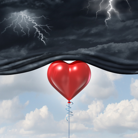 Psychology of human love or a happy romantic feeling as an antidepressant as a red heart shaped balloon lifting up and away a dark storm cloud background as a happiness metaphor for mood change in the mind.