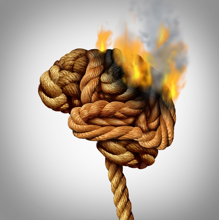 brain works: Losing brain function and memory loss due to dementia and Alzheimers disease with the medical icon of a tangled rope shaped as a human thinking organ losing functionality by flames and fire burning part of the anatomy. Stock Photo