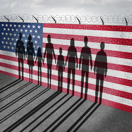 about us: American immigration and United States refugee crisis concept as people on a border wall with a US flag as a social issue about refugees or illegal immigrants with the cast shadow of a group of migrating women men and children.
