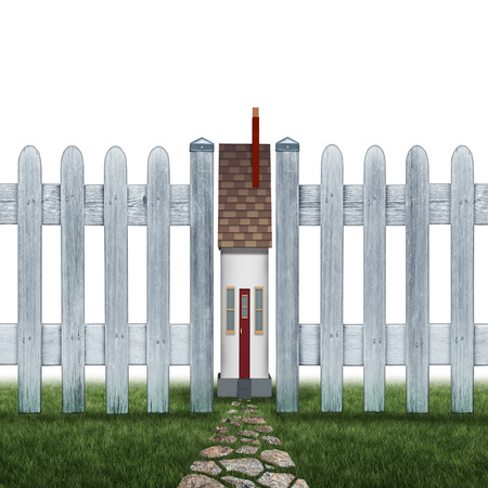 confined: Tiny house and small home concept as a confined residence real estate symbol as a very narrow family house between a picket fence as a metaphor for living in a squeezed cramped space on a white background. Stock Photo