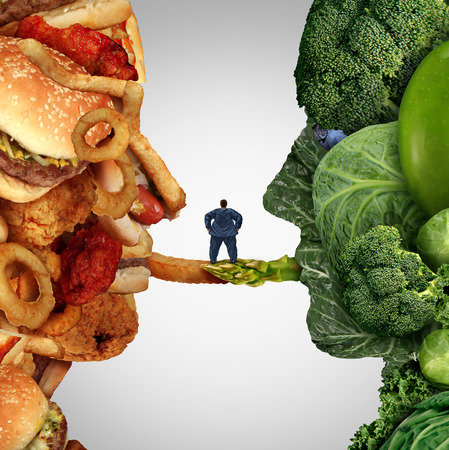 Eating options food health issue as an obese man standing on a bridge between junk food and fruit and vegetable group shaped as a human head as a concept for what to eat for health reasons symbol. Stock Photo