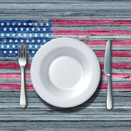 american cuisine: American cuisine food concept as a place setting with knife and fork on an old rustick wood table with a symbol of the flag of the united states as an icon of traditional family eating in america.