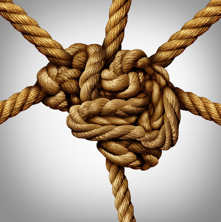 Creative process concept and creativity and the brain as a group of tangled ropes shaped as the human mind with strands of rope emerging out as an intelligence connection metaphor and neurology symbol for neuron function.