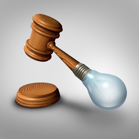 judgement: Law ideas concept and judgement symbol as a judge mallet or gavel made with a lightbulb  as a metaphor for new legislation or legal opinions and lawyer ideas.