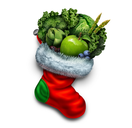 dieting: Healthy holiday eating and new year dieting resolution as a group of green vegetables and fresh fruit in a red christmas stocking as a festive symbol of a vegetarian gift or winter fitness icon.