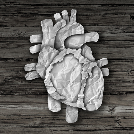 four chambers: Human heart organ concept as a circulatory anatomy made of cut crumpled paper on old rustic wood as a medical health care symbol of an inner cardiovascular body part.