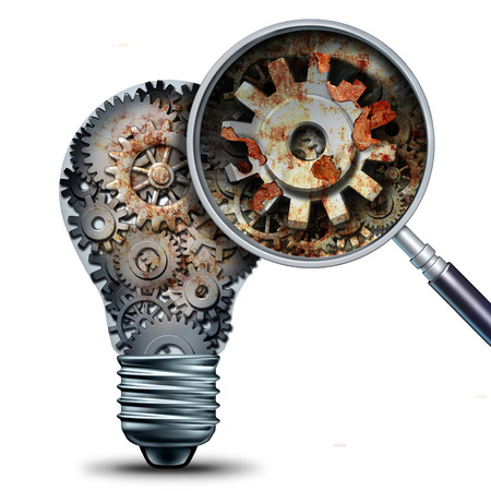antiquated: Creative decline and outdated and obsolete ideas concept as a lightbulb made of mechanical gears with a magnigying glass showing a closeup of rust and neglect as a business metaphor for losing competitivness and declining innovation.