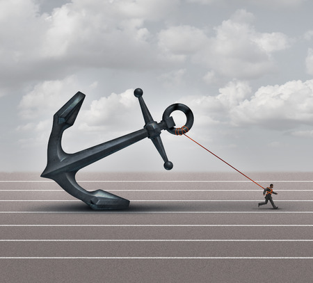 Career burden and business stress concept as a businessman or worker pulling a giant heavy metal anchor as a metaphor for hardship and strugge with taxes or oppression.