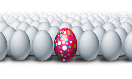 exceptional: Special decorated egg standing out as a a creative outstanding individual from a group of ordinary white eggs as an Easter celebration symbol for a spring festive tradition. Stock Photo