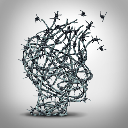 fear: Anxiety solution and freedom from fear and escape from tortured thinking and depression concept as a group of tangled barbwire or barbed wire fence shaped as a human head breaking free as a metaphor for psychological or psychiatric icon. Stock Photo