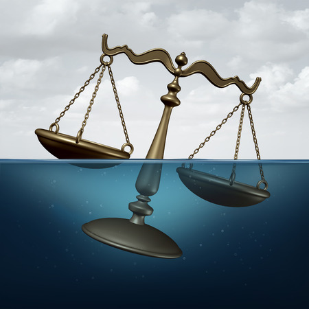 litigation: Legal trouble concept or justice problems symbol as a scale of justice drowning in water as a metaphor for law or regulation problems. Stock Photo