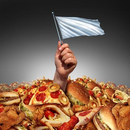 trastorno: Basura rendición de alimentos y renunciar a los alimentos grasos o renunciar a un estilo de vida y la dieta alta en grasas ayuda concepto como una mano que sostiene una flasg blanco ahogarse en un montón de comida rápida grasienta como una metáfora de cambio de hábitos alimenticios mediante la entrega al consejo de la dieta.