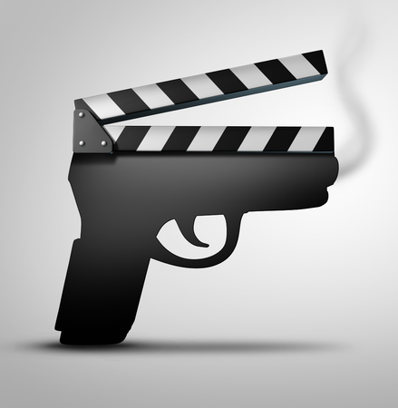 Movie violence concept or crime flick concept as a clapperboard or movie slate board shaped as a gun as a symbol for guns in television internet or movies.
