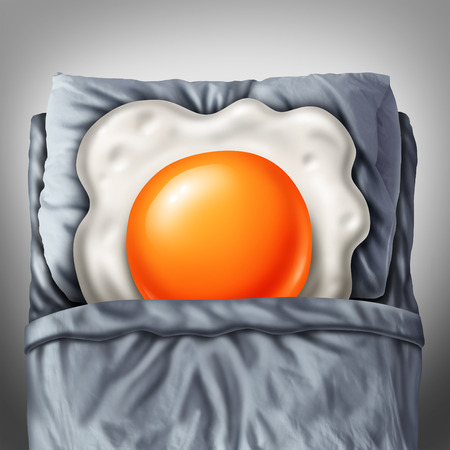 breakfast in bed: Bed and breakfast concept as a morning fried egg sunny side up resting on a pillow in a room as a metaphor for lodging and accommodation or nutrition problems symbol. Stock Photo