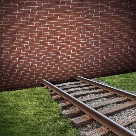 Wegblokkade of wegversperring begrip als een gesloten bakstenen muur barricade het blokkeren van een spoorlijn als een bedrijf of het leven gesloten metafoor voor de beperking van of embargo symbool. Stockfoto