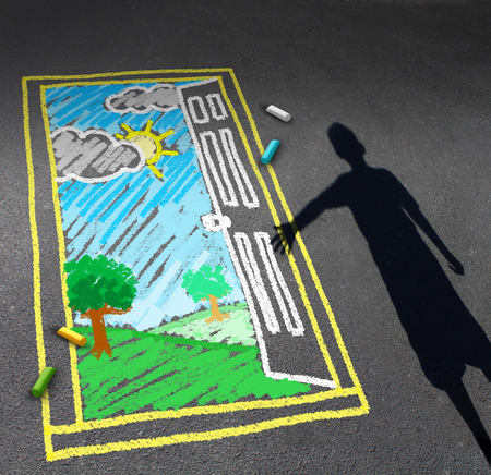 Childhood opportunity concept and child imagination symbol as a shadow of a boy looking down on a pavement with a chalk drawing of an open door with a green sunny landscape as a discovery metaphor for learning success and futur hope.