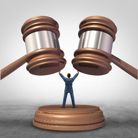 intervene: Mediation resolution and mediate legal disputes in business as a concept with a businessman or lawyer separating two judge mallets or gavel as competitors in arbitration. Stock Photo