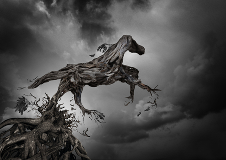 constraints: Success and potential symbol as a surreal tree horse with roots of trees shaped as a pure breed stallion breaking free from constraints to break free and move forward as a motivation for independent spirit of freedom and power. Stock Photo