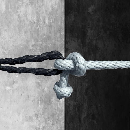 respect: Racial unity concept as a symbol against racism in society as a white and black rope tied together as a metaphor for friendship and respect.