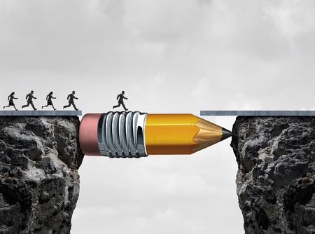 Business success symbol and conquering adversity as a group of people running from one cliff to another with the help of a pencil acting as a bridge in a concept for bridging the gap to achieve a goal. Stock Photo