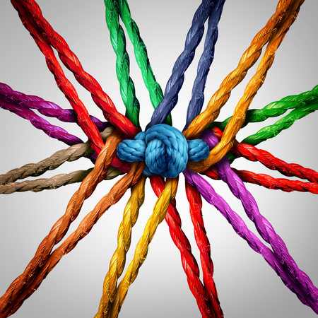 depend: Group holding together as different ropes connected and tied and linked together in the center by a knot as a strong  unbreakable chain and community trust and faith metaphor.
