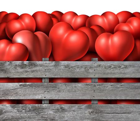 Símbolo del amor temporada como un grupo de corazones dimensionales rojos en una caja de madera rústica como un símbolo para el día de San Valentín Holyday, o el concepto de relación romántica para Datinf compromiso o matrimonio.