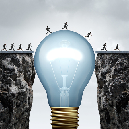 solution: Creativity business idea solution as a group of people on two divided cliffs being connected by a giant light bulb closing the gap and creating a bridge to enable a crossing to success as a cretive thinking metaphor.. Stock Photo