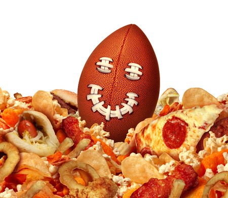 game time: Football game party snack time and tailgating food concept as a ball with a smiling face sitting in a group of game day snacks as chips chicken wings for a celebration on tv watching of the championship match.