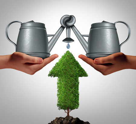 Business team funding as a crowd fund concept to invest and nurture growth opportunities together with a partnership of other investors to realize a project as diverse hands holding water pots tied together to hydrate an arrow tree. Imagens