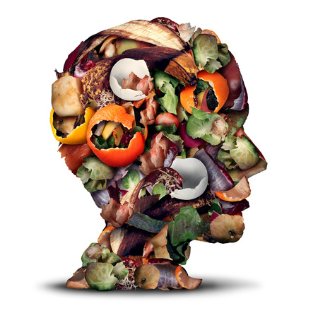 food waste: Compost thinking and composting concept as a pile of rotting kitchen fruits egg shells and vegetable food scraps shaped as a human head as organic waste for recycling as an environmentally responsible icon.
